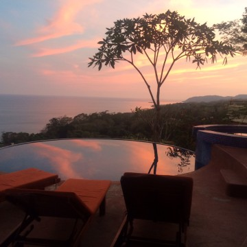 Sunset over the pool at Anamaya